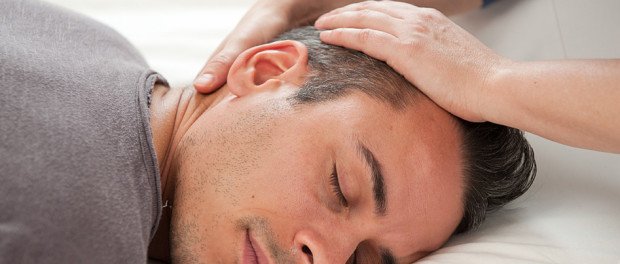 A man on Reiki treatment